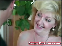 avid golden-haired granny with younger guy