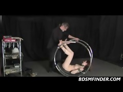 i get spanked and waxed on a bondage wheel