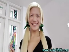 lucky mature guy plays with a young golden-haired