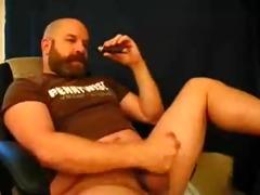 bear daddy enjoys a cigar the right way