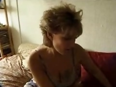 giant tit milf sucks cock and fist herself.