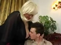 older big beautiful woman play with a young boy.