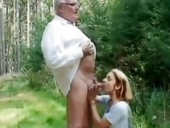 youthful girl helping an old man wi...