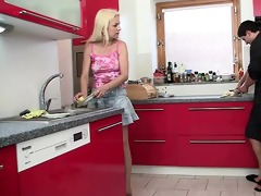 cheating sex at the kitchen with mother-in-law
