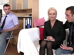 two guys share old blonde in the office