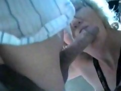 mature wife gives his cock a bj